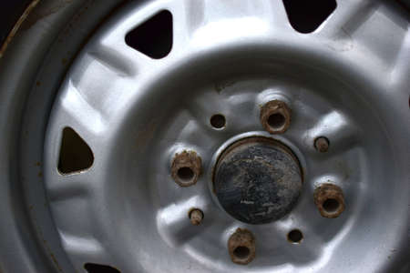 Silver wheel drive for a car with rusty bolts