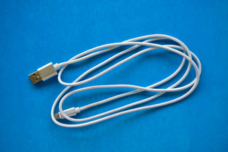 White USB cable on a blue background