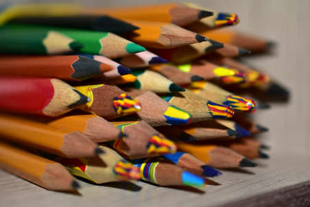 Lots of different colored pencils close up