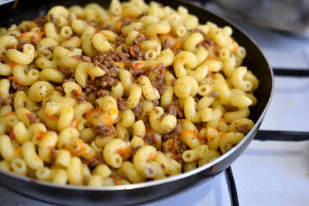 Navy pasta with meat in a saucepan Stock fotó