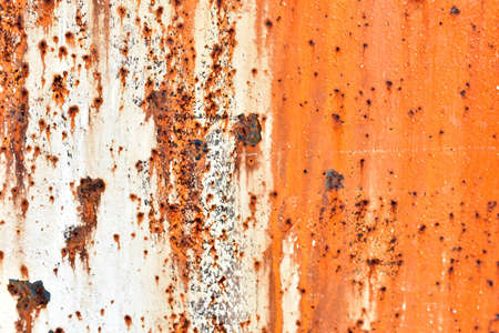 Rusty painted metal surface with flecks and scratches Foto de archivo