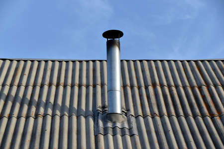 Silver iron chimney pipe of the stove in the house
