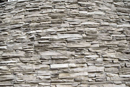 The wall of the house is masonry of yellow stone Foto de archivo