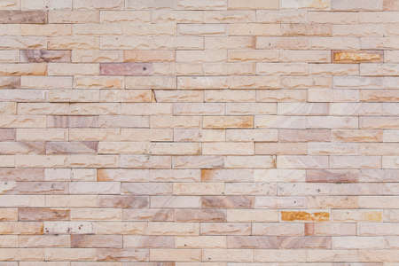solid background: beautiful sand stone brick wall Stock Photo