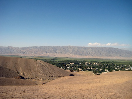 remoteness: Mountainous landscape of Kyrgyzstan with village view  Stock Photo
