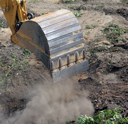 trenching: An hydraulic  excavator on a construction site during construction work  Excavation and dredging