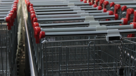 An empty metal shopping carts or Trolley photo