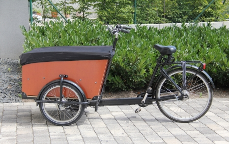 Typical modern carrier bicycle in the city  This vehicle can use for the transport of mail and other small goods Stock Photo