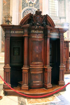 absolution: Traditional old wooden Catholic Confessional in St  Peter Cathedral in Vatican