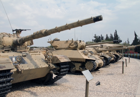 israel war:  Old military tanks built abreast Editorial