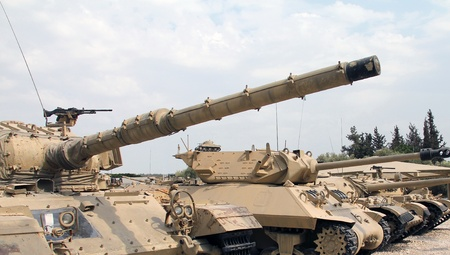 abreast:  Old military tanks built abreast Editorial