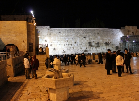 Pilgrims and tourists visiting Western wall at the night   Jerusalem, Israel   photo