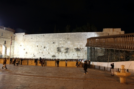 Pilgrims and tourists visiting Western wall at the night    Jerusalem, Israel  Western or Wailing wall is world known most visiting Jewish holy place photo