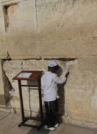 The first prayer  Unidentified  young boy are praying at the Wailing wall  Western wall  photo
