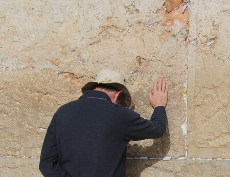 Unidentified Jews pray at the Western Wall photo