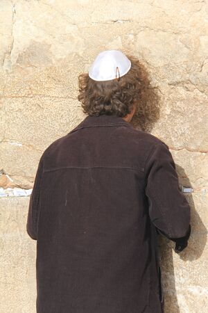 Unidentified  jewish man prays at Western wall photo