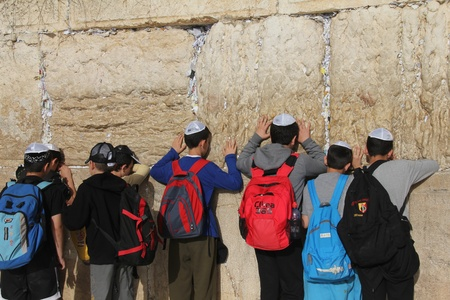Unidentified young jewish students  are praying at the Wailing wall  Western wall