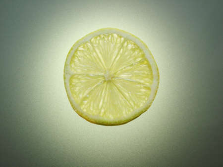 A slice of Lemon illuminated from behind Stock Photo - 16921763