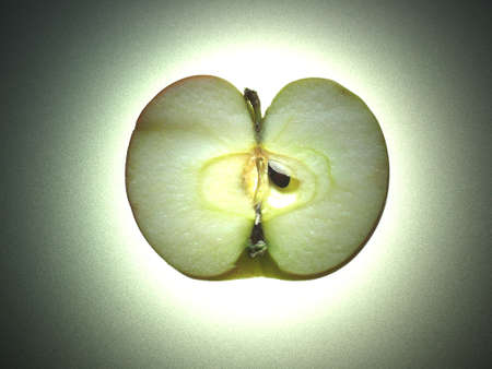 A half an apple illuminated from behind Stock Photo - 16921768