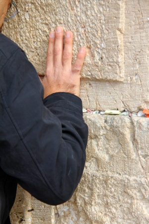 Hand of praying man on the Western Wall  in Jerusalem Stock Photo - 17350144