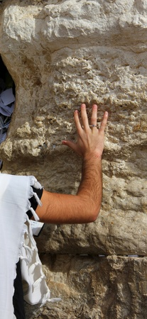 Jewish worshiper  pray at the Wailing Wall an important jewish religious site   in Jerusalem, Israel  photo