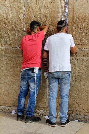 Jewish worshipers  pray at the Wailing Wall an important jewish religious site   in Jerusalem, Israel  Stock Photo - 17356607
