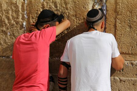 prying: Jewish worshipers  pray at the Wailing Wall an important jewish religious site   in Jerusalem, Israel