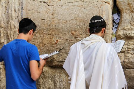 Jewish worshipers  pray at the Wailing Wall an important jewish religious site   in Jerusalem, Israel  Stock Photo - 17356601