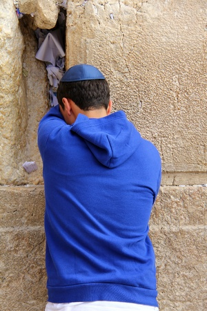 Jewish worshiper  pray at the Wailing Wall an important jewish religious site   in Jerusalem, Israel