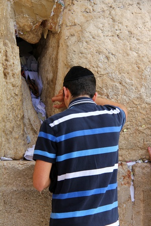 Jewish worshiper  pray at the Wailing Wall an important jewish religious site   in Jerusalem, Israel  Stock Photo - 17356603