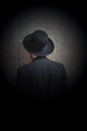 Jewish worshiper  pray at the Wailing Wall an important jewish religious site   in Jerusalem, Israel Stock Photo - 17566061
