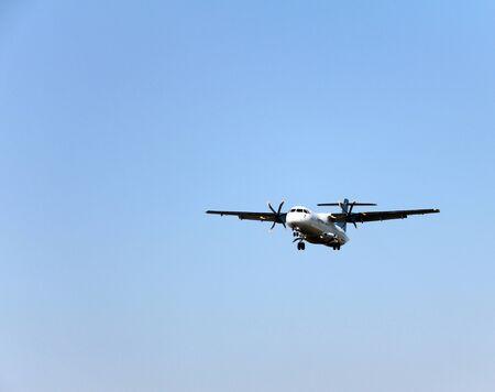 turboprop: Turboprop regional passenger airplane landing at airport  Stock Photo