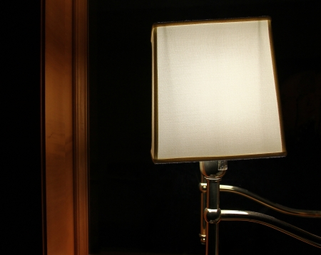 bedside: Bedside lamp at hotel