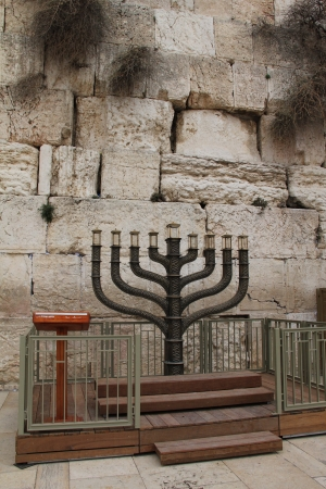 Big menorah on Western Wall background photo