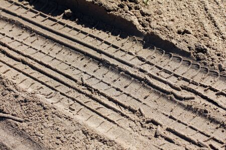 sandy soil:  Tire Trace in the sand
