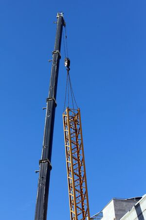 Tower crane dismantling on blue sky background Stock Photo - 18165216