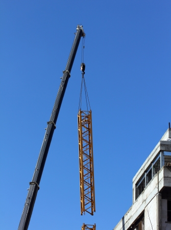 Tower crane dismantling on blue sky background Stock Photo - 18164855