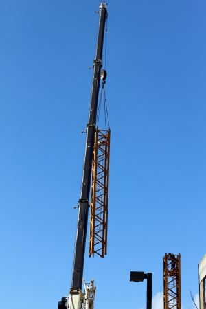 Tower crane dismantling on blue sky background Stock Photo - 18153626