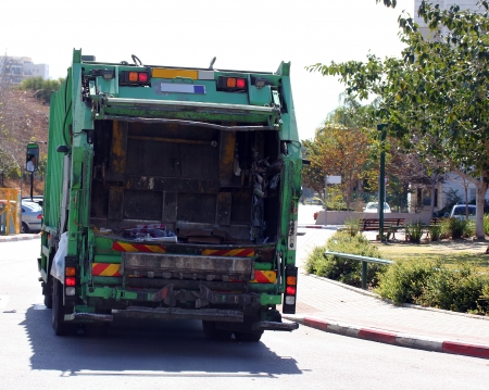 Garbage truck on the street photo