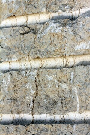 stone cutter: Surface of the  limestone  texture close up with drilling trace. Selective focus. Stock Photo