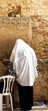 Unidentified man in tefillin  praying at the Wailing wall  Western wall   Jerusalem  Israel photo