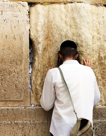 Unidentified young man praying at the Wailing wall  Western wall  photo