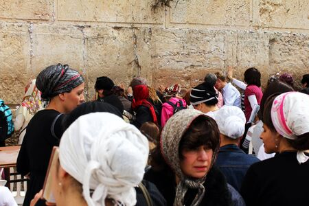 Jewish worshipers   women  pray at the Western Wall an important jewish religious site in Jerusalem, Israel