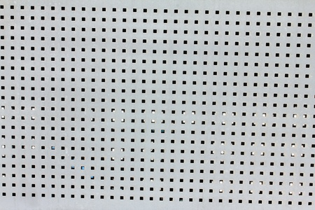 Abstract background with texture of  perforated metal plate. photo