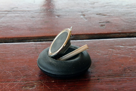 Ashtray and cigarette on the wooden table photo