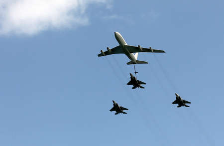 Israeli Air Force airplanes (four-engine turboprop powered refueling tanker  and three jet fighters) imitating aerial refueling at parade in honor of Independence Day photo