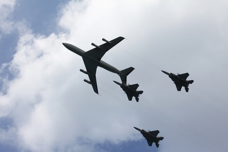 Air Force airplanes  four-engine turboprop powered refueling tanker  and three jet fighters  imitating aerial refueling at parade in honor of Independence Day on April 16 in Tel Aviv, Israel photo