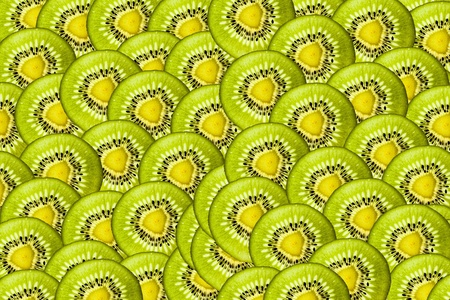 slivers: Background is of sliced thin slivers of kiwi Stock Photo