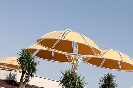 sunshades: Yellow sunshades on the beach Stock Photo