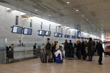Passengers wait in reception area of tickets and luggage at the airport Ben Gurion Airport   Тerminal number 3 officially opened in 2004 and is one of the busiest airports at Middle East , which meets modern requirements to international airports